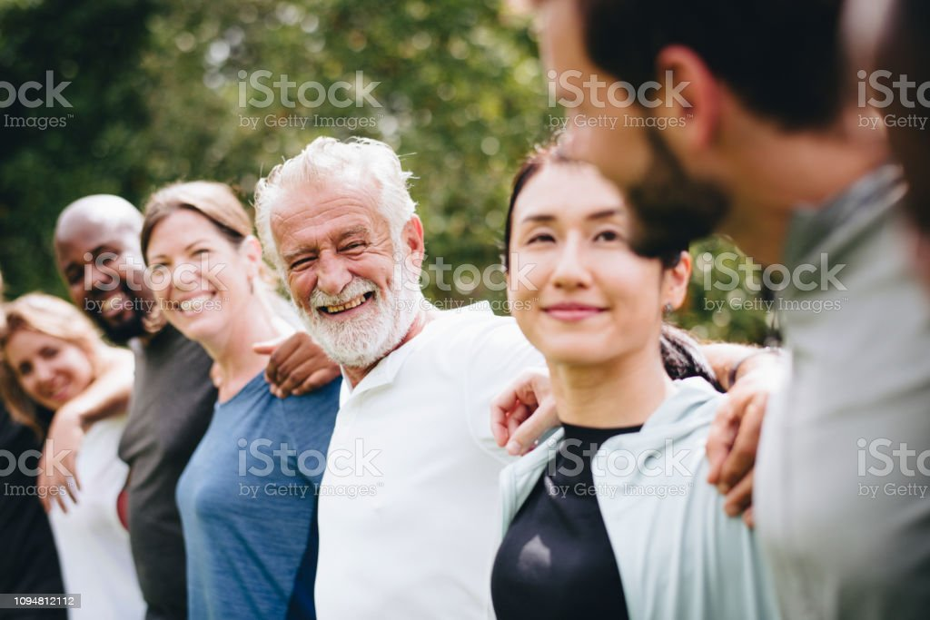 Happy diverse people together in the park stock photo