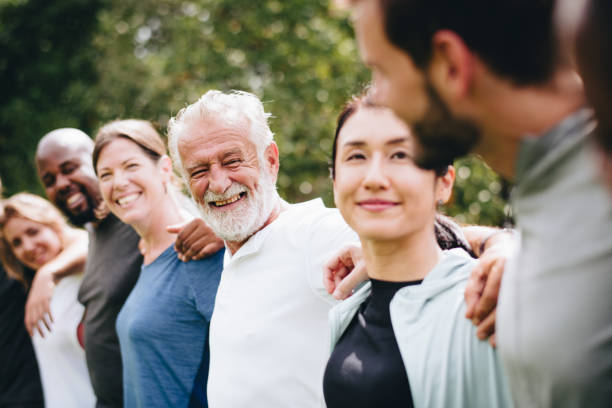 happy diverse people together in the park - geriatrics stock pictures, royalty-free photos & images