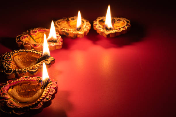 happy diwali - clay diya lamps lit during dipavali, hindu festival of lights celebration - diwali stock pictures, royalty-free photos & images