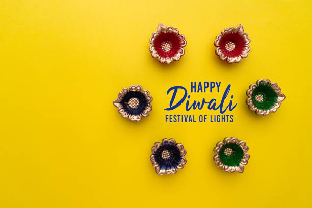 Happy Diwali - Clay Diya lamps lit during Dipavali, Hindu festival of lights celebration. Colorful traditional oil lamp diya stock photo