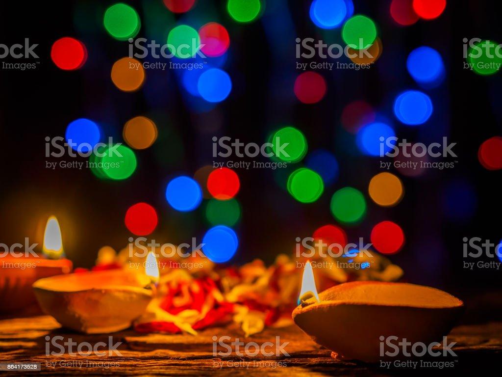 Happy Diwali - Diya lamps lit with bokeh background during diwali celebration. royalty-free stock photo