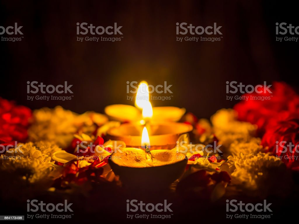 Happy Diwali - Diya lamps lit with flowers during diwali celebration. royalty-free stock photo