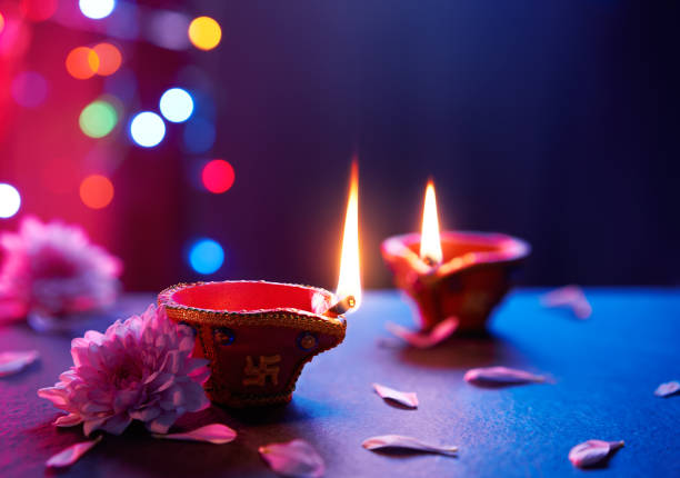 happy diwali - diya lamps on floor with bokeh light background - diwali stock pictures, royalty-free photos & images