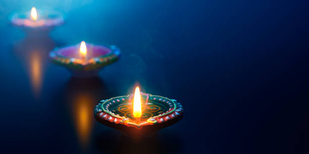 happy diwali - diya oil lamps lit during celebration - diwali stock pictures, royalty-free photos & images