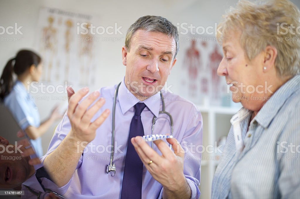 happy doc with senior patient royalty-free stock photo