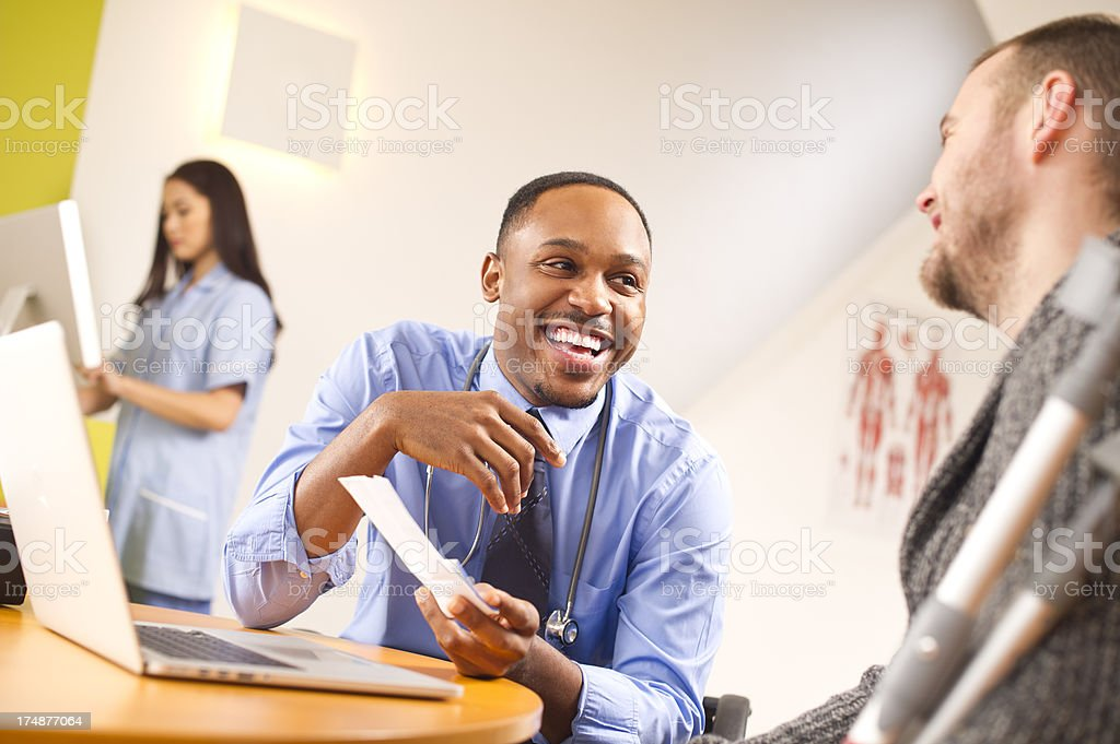 happy doc with young male patient stock photo