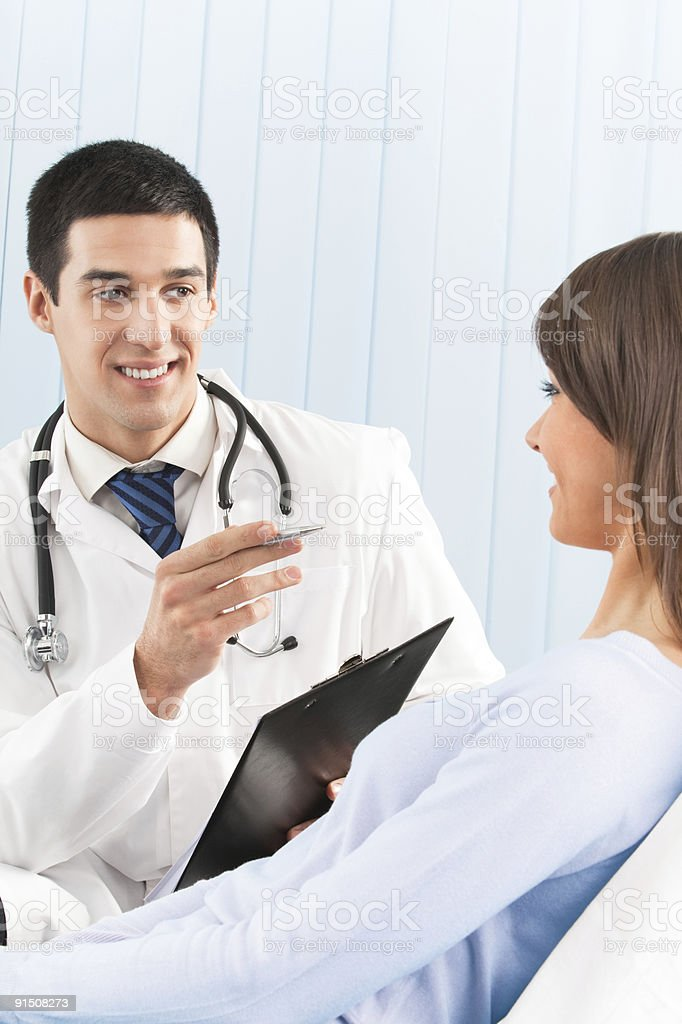 Happy doctor and female patient at office royalty-free stock photo