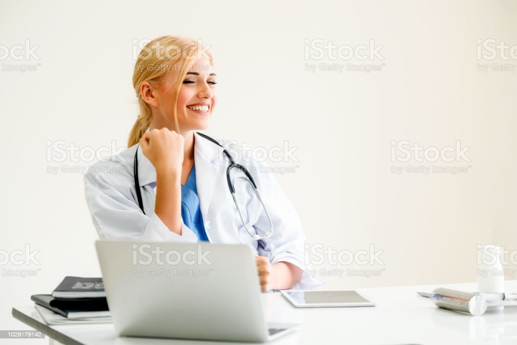 Happy doctor in hospital. Medical success concept. stock photo