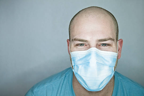 Happy Doctor or Patient (smiling with the eyes) stock photo