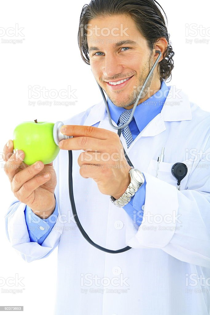Happy Doctor Promoting Healthy Eating royalty-free stock photo
