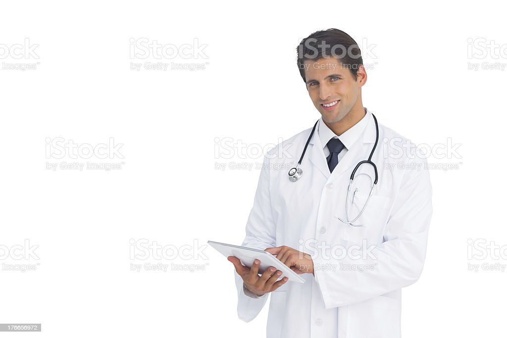 Happy doctor using a tablet royalty-free stock photo