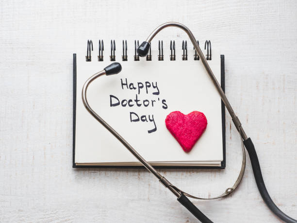 Happy Doctor's Day. Beautiful greeting card. Isolated background Happy Doctor's Day. Beautiful card. Sketchbook with congratulatory inscription. Isolated background, wooden surface. Congratulations for loved ones, relatives, friends and colleagues day stock pictures, royalty-free photos & images