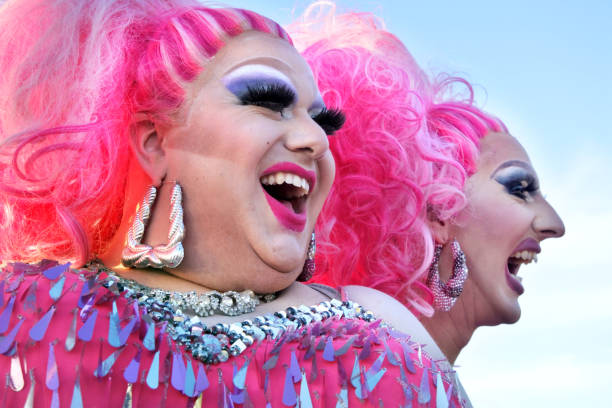 Happy Drag queens laughing Auckland: Happy drag queens laughing. A drag queen is a male who dresses in clothing of the opposite sex, acts with exaggerated femininity in feminine gender roles for entertainment or fashionHappy drag queens laughing. A drag queen is a male who dresses in clothing of the opposite sex, acts with exaggerated femininity in feminine gender roles for entertainment or fashion diva human role stock pictures, royalty-free photos & images