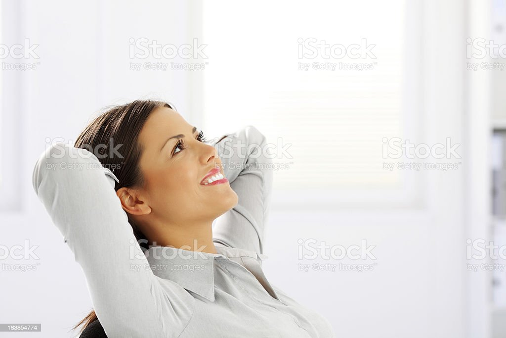 Happy dreaming business woman looking up. royalty-free stock photo