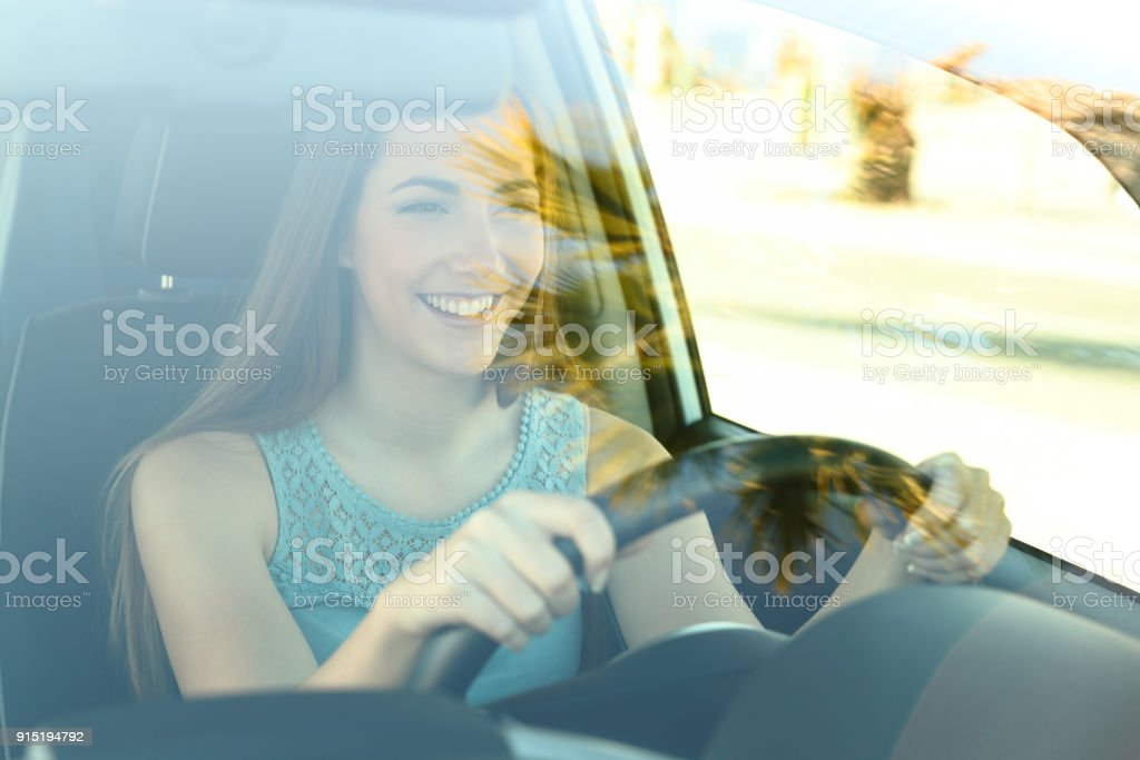 Happy driver driving a car stock photo