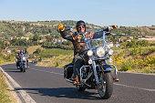 happy driver riding Harley Davidson
