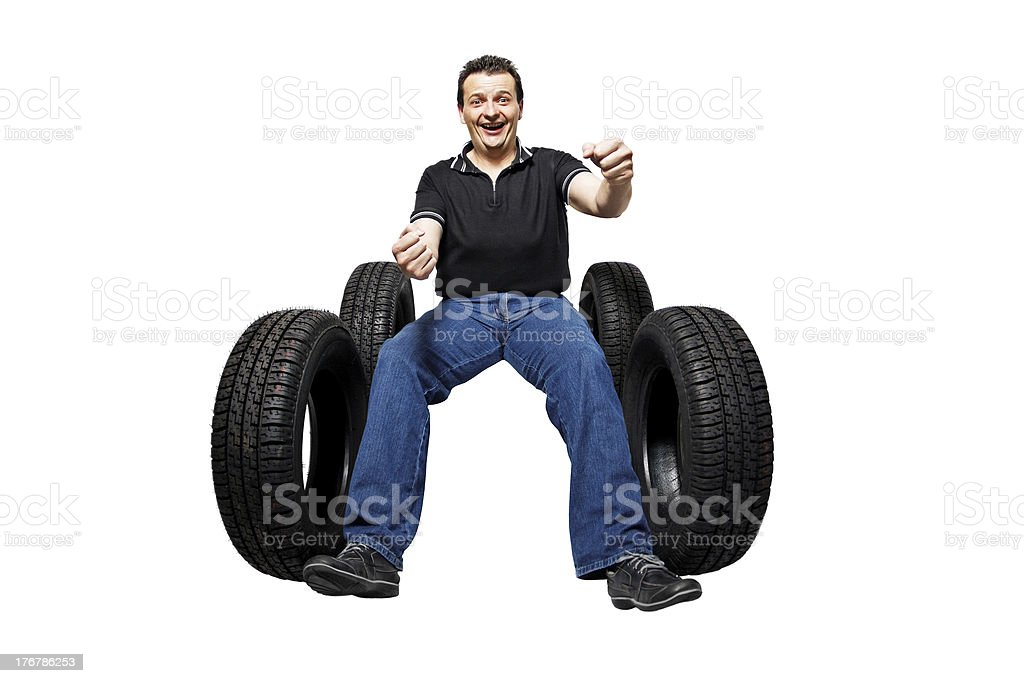 Happy driver with new tires royalty-free stock photo