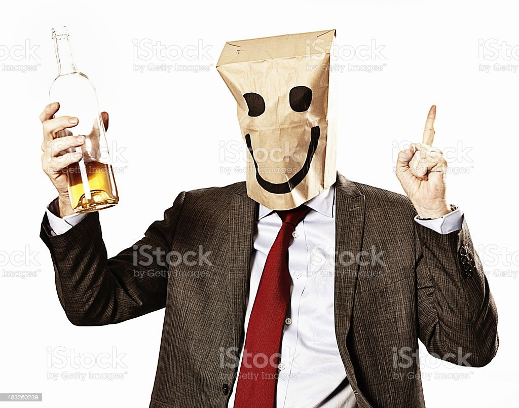 Happy drunk in paper-bag mask points upwards royalty-free stock photo