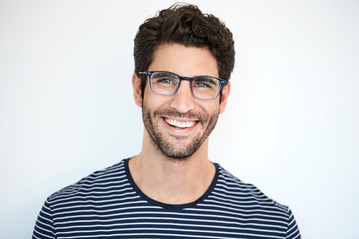 Happy dude in striped top and glasses, portrait