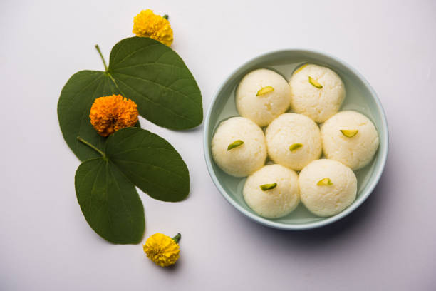 Happy Dussehra / Vijayadashami / Ayudh Puja greeting card using apta/Bauhinia racemosa/Bidi leaf and indian sweet Rasgulla for Navaratri stock photo