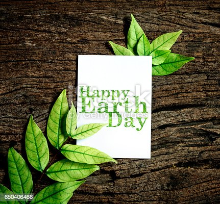 istock Happy Earth Day paper sheet with fresh spring  green leafs 650406466