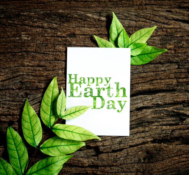 happy earth day paper sheet with fresh spring  green leafs - earth day stock pictures, royalty-free photos & images
