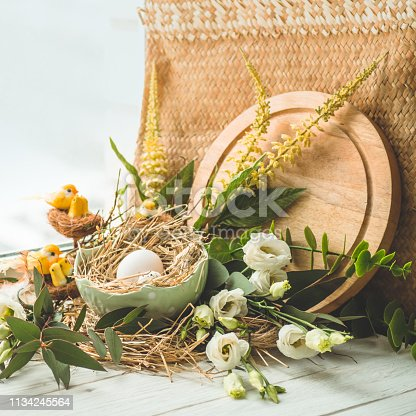 istock Happy Easter background. Easter egg in a nest with floral decoration near the window. Quail eggs. Happy Easter concept 1134245564