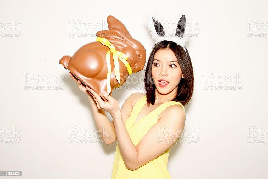 Happy Easter bunny girl with Rabbit chocolate stock photo