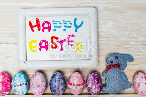 Happy Easter card with creative painted and decorated eggs