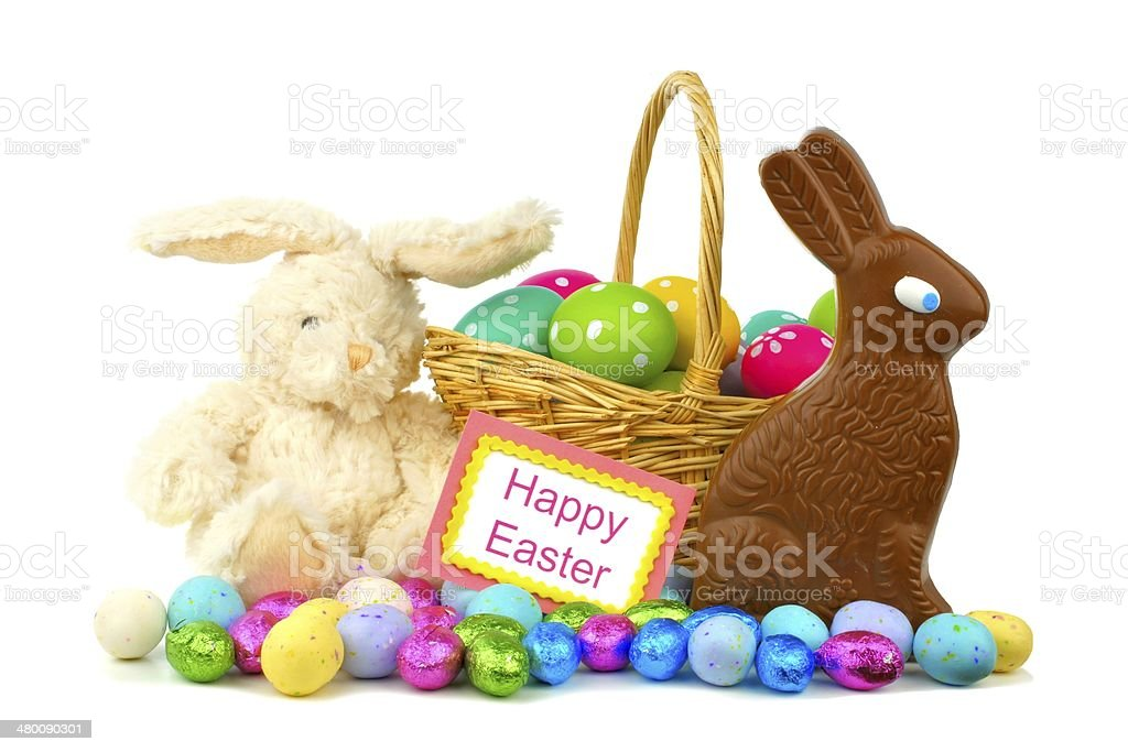 Happy Easter card with Easter toys and candy over white stock photo