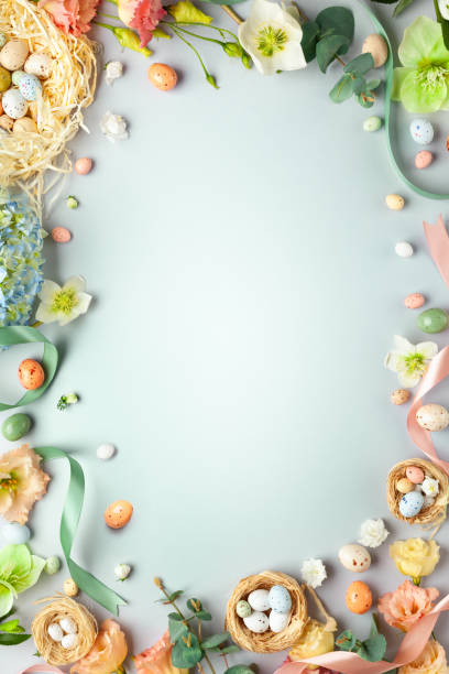 happy easter concept with easter eggs in nest and spring flowers. - easter imagens e fotografias de stock