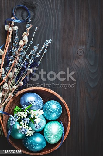 istock Happy Easter. Congratulatory easter background. Easter eggs and flowers. Background with copy space. Selective focus. 1132232636