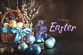 Happy Easter. Congratulatory easter background. Easter eggs and flowers. Selective focus. Horizontal