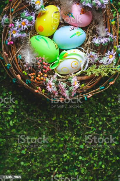 Happy easter congratulatory easter background easter eggs and flowers picture id1209827568?b=1&k=6&m=1209827568&s=612x612&h=0m4oeowbqryvkg17lkvnukzqerj0r wycqgbhrnqk2s=