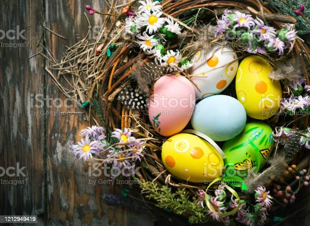 Happy easter congratulatory easter background easter eggs and flowers picture id1212949419?b=1&k=6&m=1212949419&s=612x612&h=jtijfgo8zaqn1m9rl dkconiqqpspqy3i nlqep0v2e=