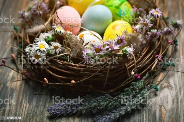 Happy easter congratulatory easter background easter eggs and flowers picture id1212959145?b=1&k=6&m=1212959145&s=612x612&h=x ff9efjj 3u0u2desgcgxymjhbffkmaamu2pobqicm=