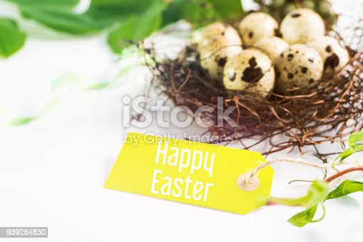 922661892 istock photo Happy Easter. Easter greeting card. quail eggs in the nest. 939284830
