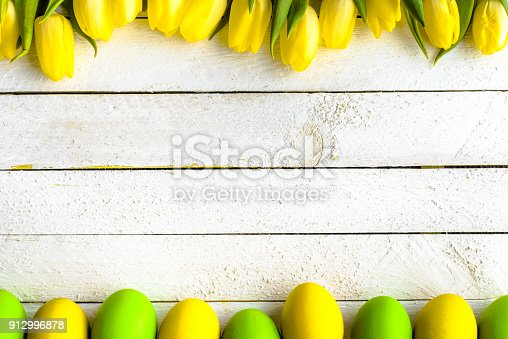 istock Happy easter eggs, background with tulips and eggs, top view 912996878