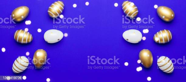 Happy easter eggs blue background golden shine decorated eggs in for picture id1205419726?b=1&k=6&m=1205419726&s=612x612&h=4qjd4s1ksry5bx7nwjucazmun ohpuofq9iuab mduw=