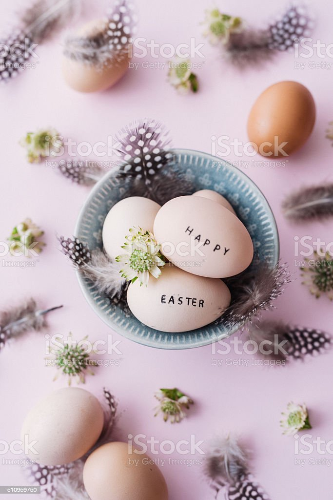 Happy easter eggs with feathers and text stock photo