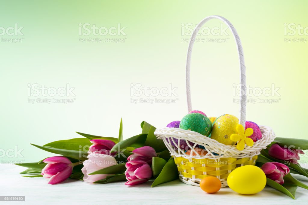 Happy Easter elegant background with painted eggs in yellow basket royalty-free stock photo