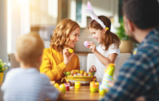 Happy easter! family mother, father and children paint eggs for   holiday Happy easter! family mother, father and children paint eggs for the holiday easter stock pictures, royalty-free photos & images
