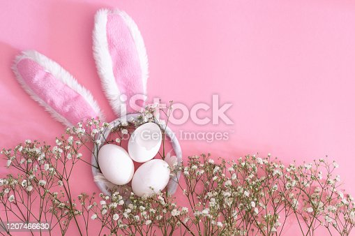 1135121547 istock photo Happy Easter. Flat Lay of easter ears and gypsophila flowers on a pink background. Easter background. 1207466630