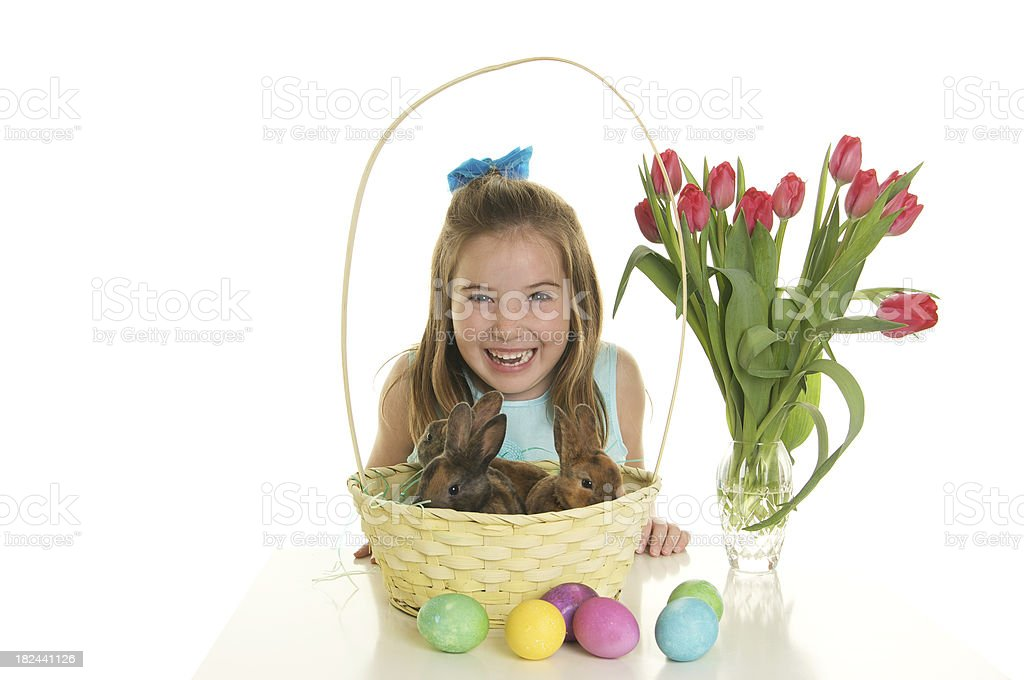 Happy Easter Girl with Bunnies in a Basket royalty-free stock photo