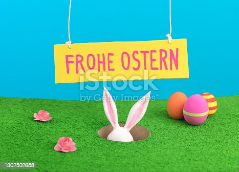 istock Happy Easter greeting card on German 1302502658