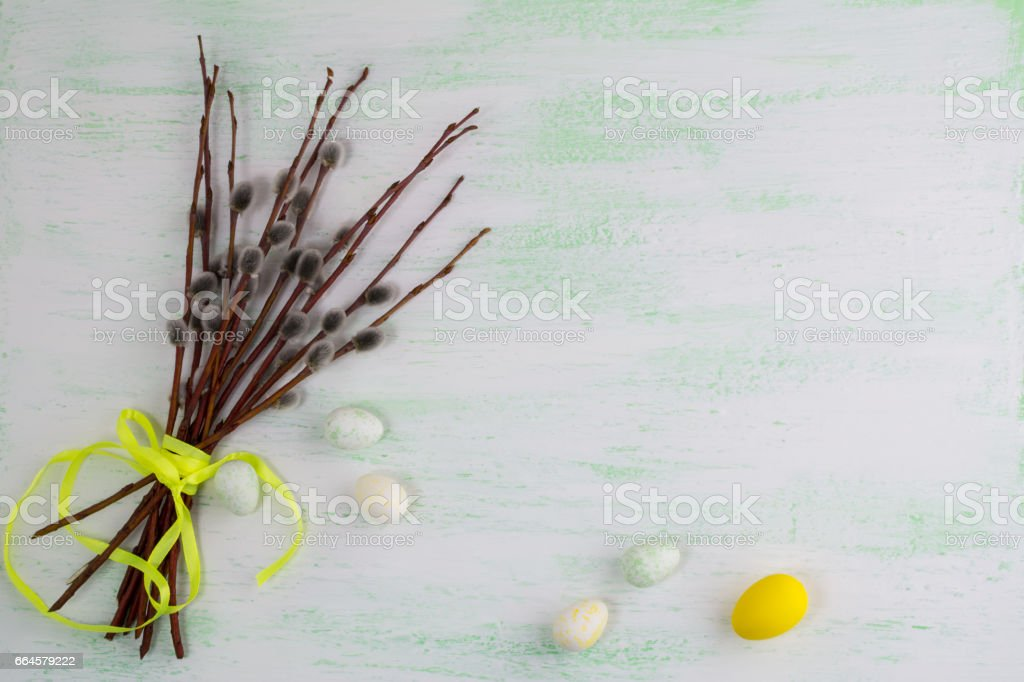 Happy Easter greeting with eggs and willow tree branch. stock photo