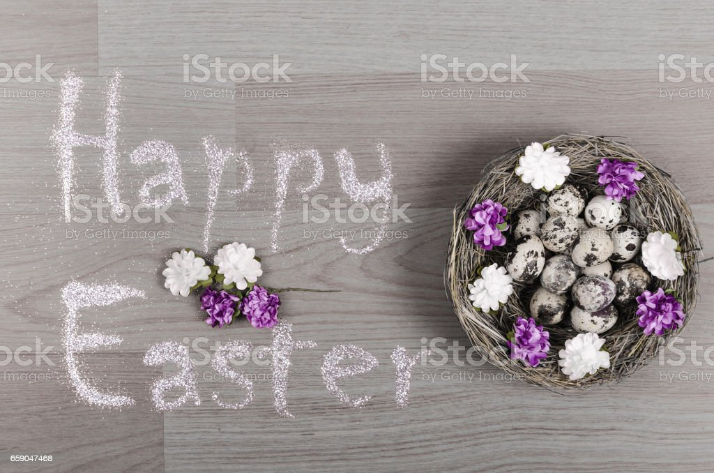 Happy Easter greeting with eggs over rustic wooden gray background royalty-free stock photo