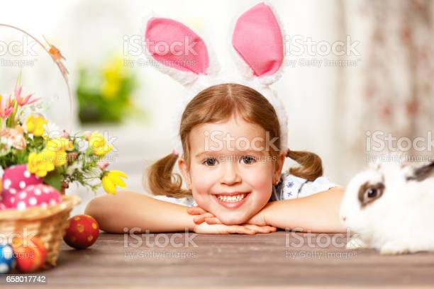Happy easter happy funny child girl playing with bunny picture id658017742?b=1&k=6&m=658017742&s=612x612&h=1gqybw3et2kakvpcvbv2ozxpeafmtedvd efo3l1wq0=