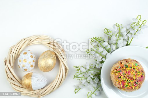 Happy Easter. Painted eggs on white background. Easter Cake - Russian and Ukrainian Traditional Kulich, Paska Easter Bread. Top view. Copy space for text