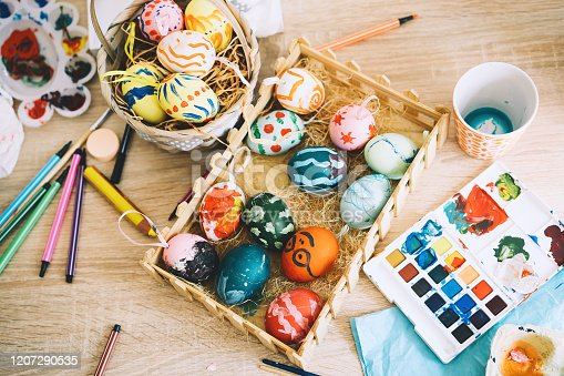 istock Happy Easter! Painting eggs. Paints, felt-tip pens, decorations for coloring eggs for holiday. Creative background. 1207290535